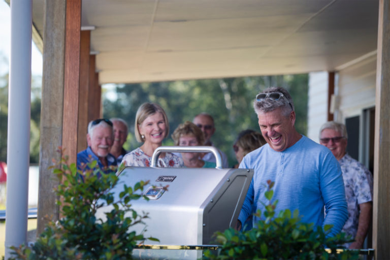 Group of over 50s enjoying a BBQ at Freshwater Ingenia.