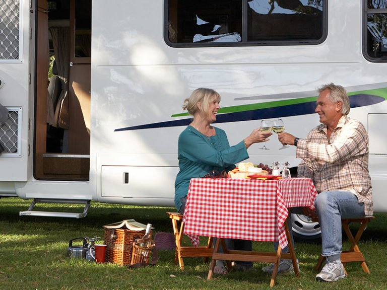 Over 50s couple enjoying a picnic and wine in North Brisbane.