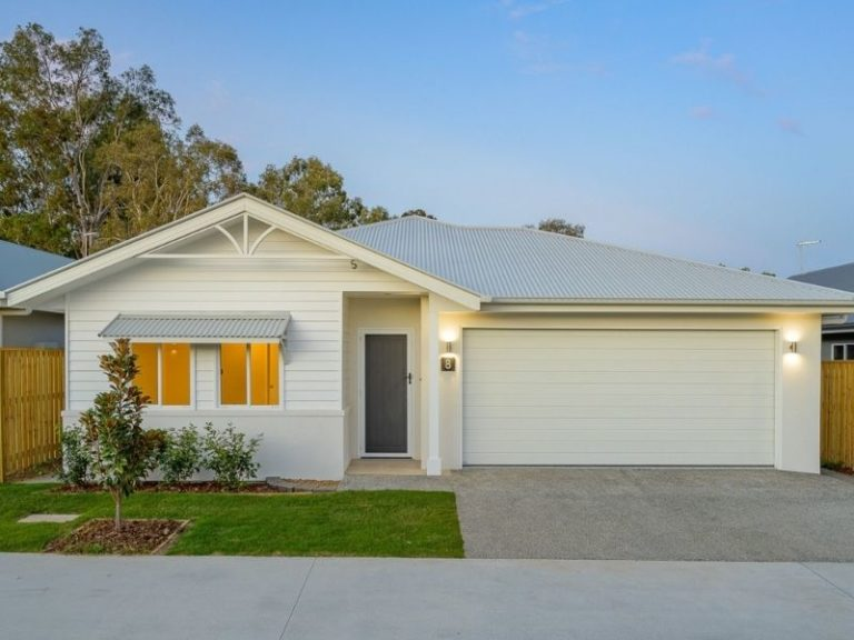 Freshwater Exterior Front Of A Marlborough Home With A Two Car Indoor Garage On The Right And Small Garden On The Left