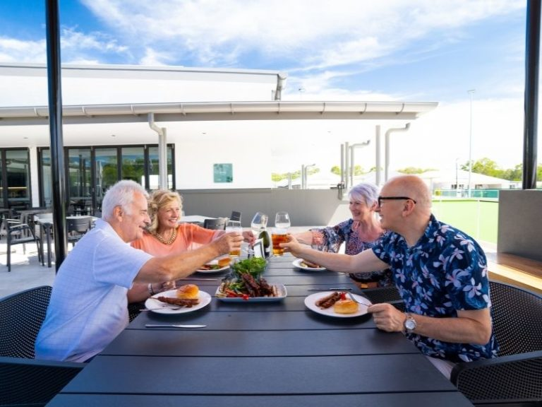 Couples having dinner and drinks at Freshwater Village