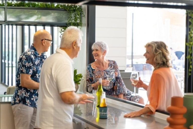 Group of over 50s have drinks t the opening of Freshwater village Burpengary