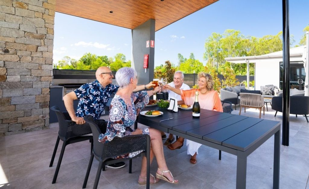 Group of over 50s toasting at Freshwater.